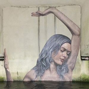 Artist Sean Yoro's Clara is a captivating image of a woman embracing a confined space. Yoro was one of 20 artists from all over the world who took part in the CANVAS Outdoor Museum Show West Palm Beach, Nov. 8 -22, 2015. Photo credit: Instagrafite