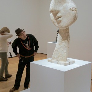 Helander viewing Pablo Picasso, Head of a Woman, 1932, plaster, 52 ½ x 25 5/8 x 28 in. Photo by Robert W. Cuffey.
