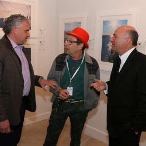 "Left to right: Art Wynwood fair producer Nick Korniloff (Art Miami LLC), artist/critic Bruce Helander and photographer Kevin O'Leary (""Shark Tank"") at the opening of O'Leary's exhibition during Art Wynwood 2016. Photograph by Christopher Fay."
