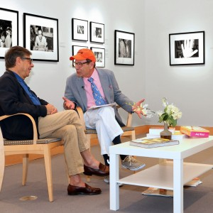 Bob Colacello (on left) being interviewed by Bruce Helander at In and Out with Andy, Colacello's exhibition of his candid Warhol photographs. Photographed at the Boca Raton Museum of Art by Christopher Fay.