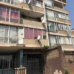 An outside view of one of Johannesburg's squatter apartment complexes. Photos by author, Sept. 10, 2017.