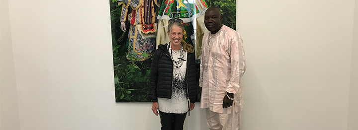 "South Africa. In the background is Agbodjélou's 2015 work entitled ""Egungun Masquerade VI"" ©. Photo taken Sept. 16, 2017."