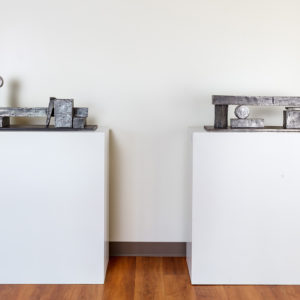 Hubert Phipps, (left) Pieces of Eight, 2015, Cast stainless steel, 14 x 29.5 x 8 in. (35.56 x 74.93 x 20.32 cm); (right) Pieces of Six, 2016, Cast stainless steel, 9 x 29.5 x 8 in. (22.86 x 74.93 x 20.32 cm)