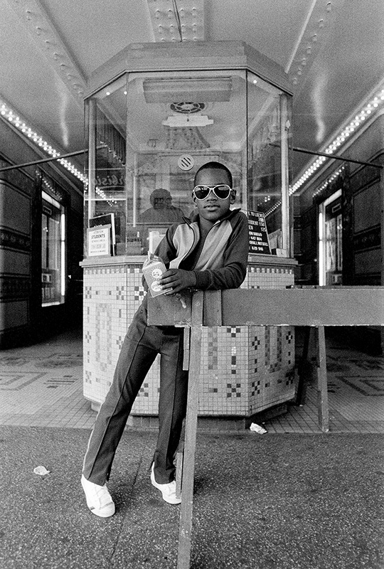 Bey_A-Boy-in-front-of-the-Loews-125th-Street-Movie-Theater_1976